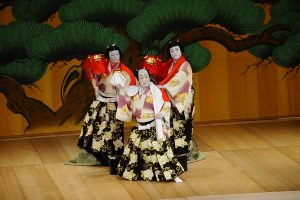 """The kabuki play, """"Renjishi,"""" is the story of the white-haired father shishi (mystical lion) and his two red-haired shishi cubs. The opening of the play is told through a dance with puppets. From left: Fukunosuke Nakamura, Shikan Nakamura (front) and Hashinosuke Nakamura. (Photo by Wayne Shinbara)"""