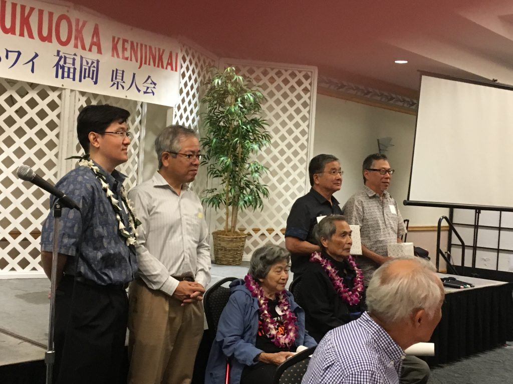 Edith Tamanaha, age 88, and 80-year-old Richard Wakida, both seated, were recognized during the Keiro portion of the program. Also recognized were centenarians Yaeko Kobayashi, represented by son Bertrand, and Haruko Nomura, represented by her son Myles. Hawaii Fukuoka Kenjin Kai president Keith Sakuda and Consul General of Japan Koichi Ito are also pictured.