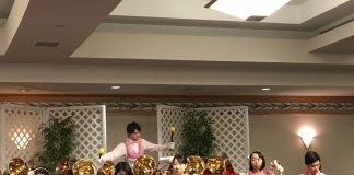 Professor Hirotaka Arai leads the Hakuoh University Handbell Choir playing their numerous handbells.