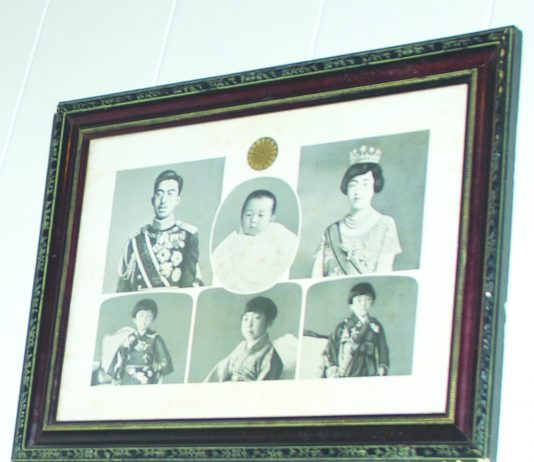 "A framed collection of Emperor Akihito's baby and childhood photos and his parents is part of the Japanese Cultural Center of Hawaii's ""Okage Sama De"" exhibit. (Photo by Kevin Kawamoto)"