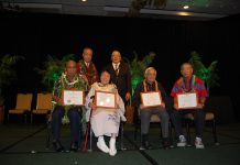 "The 2019 ""Living Treasures of Hawai'i."" Seated from left are Earl Kawa'a, Gertrude Tsutsumi, John Hara and Jimmy Yagi. Standing behind them are Bishop Eric Matsumoto of the Honpa Hongwanji Mission of Hawaii and its president, Pieper Toyama."