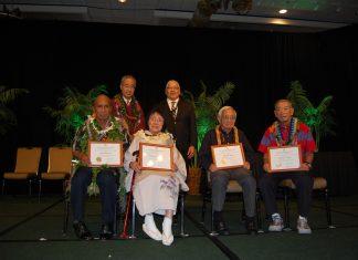 "The 2019 ""Living Treasures of Hawai'i."" Seated from left are Earl Kawa'a, Gertrude Tsutsumi, John Hara and Jimmy Yagi. Standing behind them are Bishop Eric Matsumoto of the Honpa Hongwanji Mission of Hawaii and its president, Pieper Toyama."