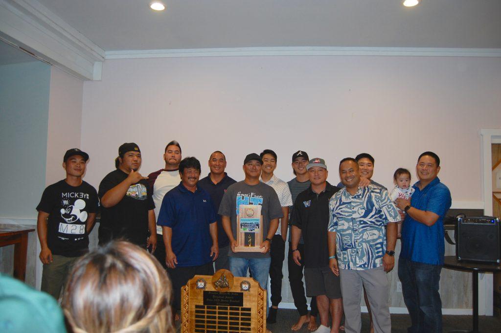 Members of the Oahu AJA League championship team, Waipahu, gather for a group photo (from left): Landen Taga, Chevas Numata, Zach Kometani, Nelson Inabata, Moku Paiva, Blane Muraoka, Hunter Hirayama, Revan Wong, Ricky Tahara, Kaipo Paiva, David Torigoe and Shaun Kiriu with his son Cooper.