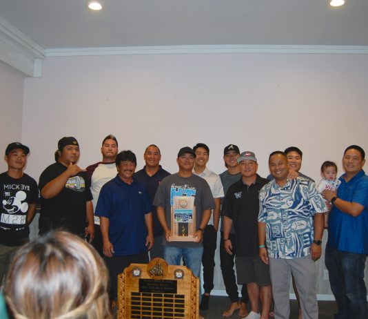 Members of the Oahu AJA League championship team, Waipahu, gather for a group photo (from left): Landen Taga, Chevas Numata, Zach Kometani, Nelson Inabata, Moku Paiva, Blane Muraoka, Hunter Hirayama, Revan Wong, Ricky Tahara, Kaipo Paiva, David Torigoe and Shaun Kiriu with his son Cooper.