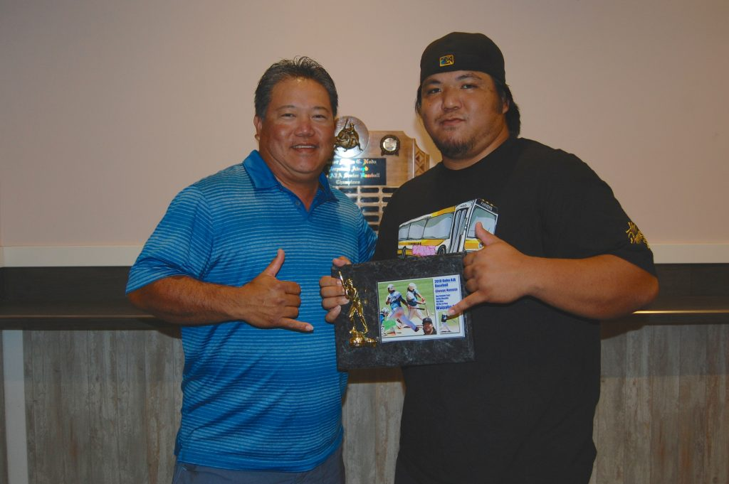 Nathan Numata with his son Chevas, who received the 2019 Oahu AJA League's Most Valuable Player Award. In 2015, Chevas won the tournament's Most Outstanding Player Award, the same award his father won in 2000. They became the first father-son MOP combination in the history of the State AJA Baseball Tournament. (Photos by Jodie Ching)