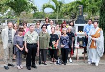 Members of the Kuakini Auxiliary and Kuakini's healthcare team in front of the Kuakini columbarium following the May 28 memorial service. At the far right is the Rev. Takamasa Yamamura. Kuakini Health System president and CEO Gary Kajiwara stands in the front row, third from the left. (Photo courtesy of Kuakini Health Systems)