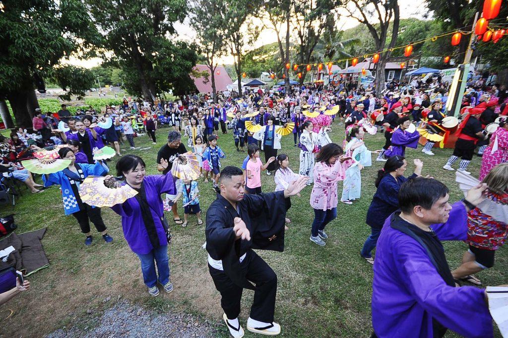 From keiki to küpuna, honoring the spirits of their loved ones at Hawaii's Plantation Village. (Photos by Wayne Shinbara)