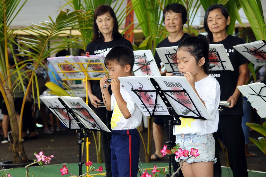 Members of all ages from the Hawaii Reed 21 Harmonica Band entertained the audience.