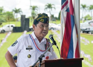 Recently retired broadcast journalist and Afghanistan war veteran Wayne Yoshioka addresses the Memorial Day audience at the East Hawaii Veterans Cemetery in Hilo. (Courtesy Hawaii Tribune-Herald)
