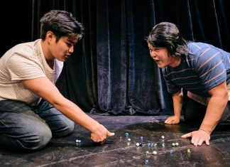Junior (Ku'umakaonaona Bailon) and Bobo (Brandon Hagio) having fun playing marbles. (Courtesy Kumu Kahua Theatre)