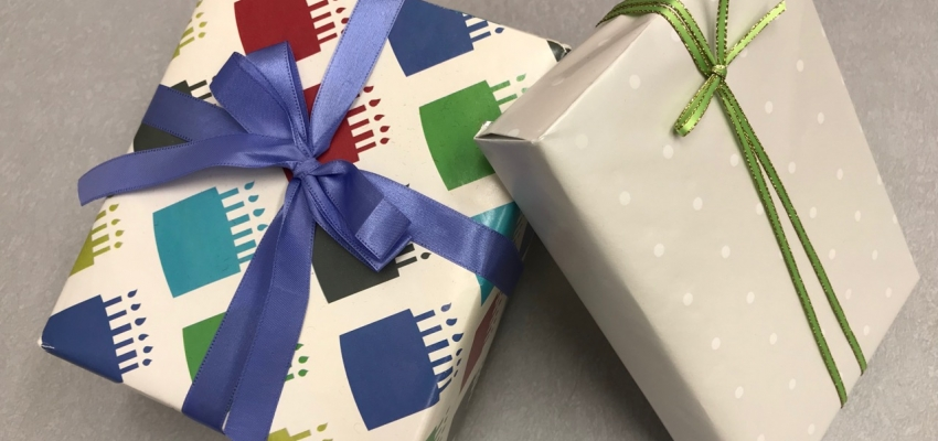Photo of 2 wrapped gifts promoting upcoming Japanese Department Store Gift Wrapping Workshop