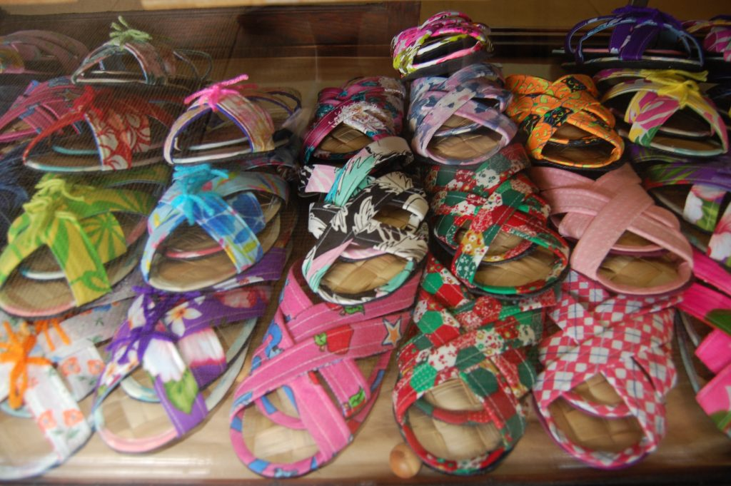So many colorful lauhala house slippers!