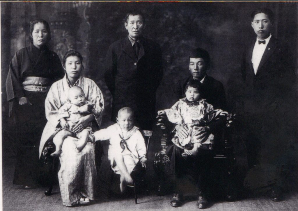 Matsuichi and Harue Yamaguchi and their family. Harue's parents (Mr. and Mrs. Yoshikami) and her uncle, Susumu, stand behind the couple. Harue holds son Jiro on her lap while Ichiro sits next to them while Matsuichi holds daughter Amy on his lap. (Photo from the Ichiro Yamaguchi Collection)