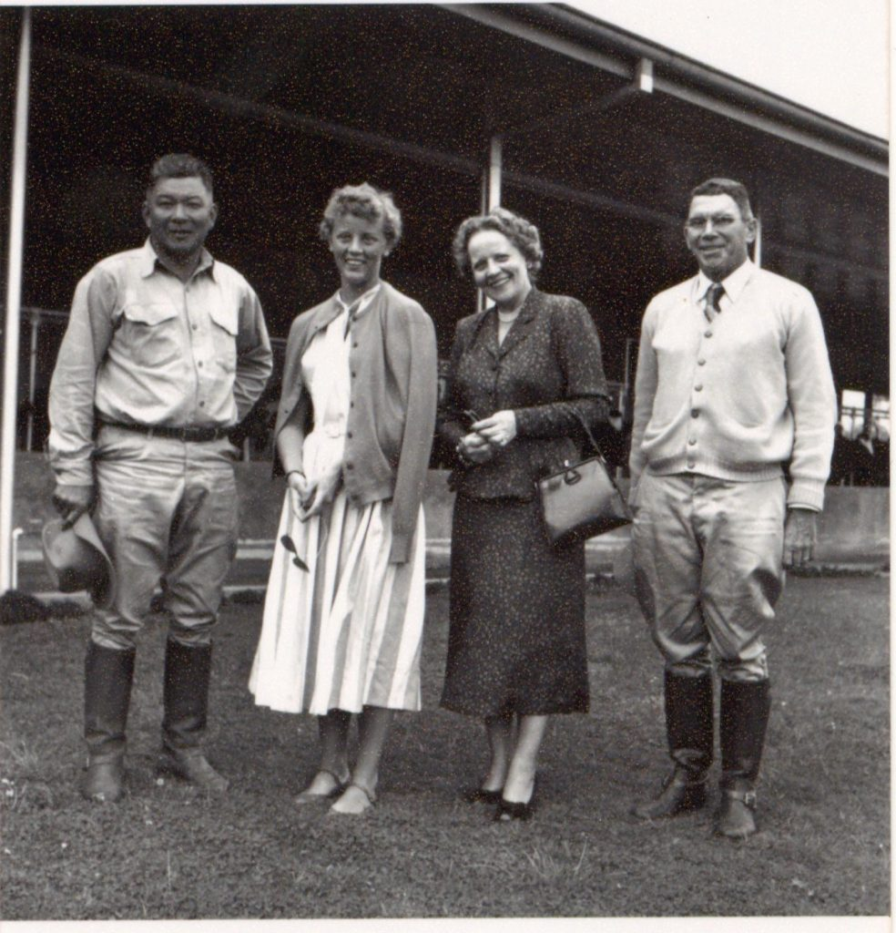 Yutaka Kimura (far left) and Parker Ranch manager Dick Penhallow in front of the new Pu'ukapu Dairy Facility with two British guests. (Photo from the Dick Penhallow Collection)
