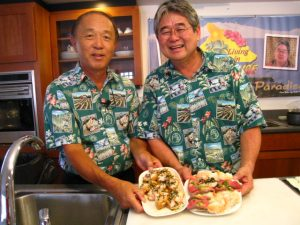 """""""Seniors Living in Paradise"""" co-hosts George Yoshida (left) and Derek Kurisu show off some simple dishes they prepared. (Photo courtesy KTA Super Stores)"""