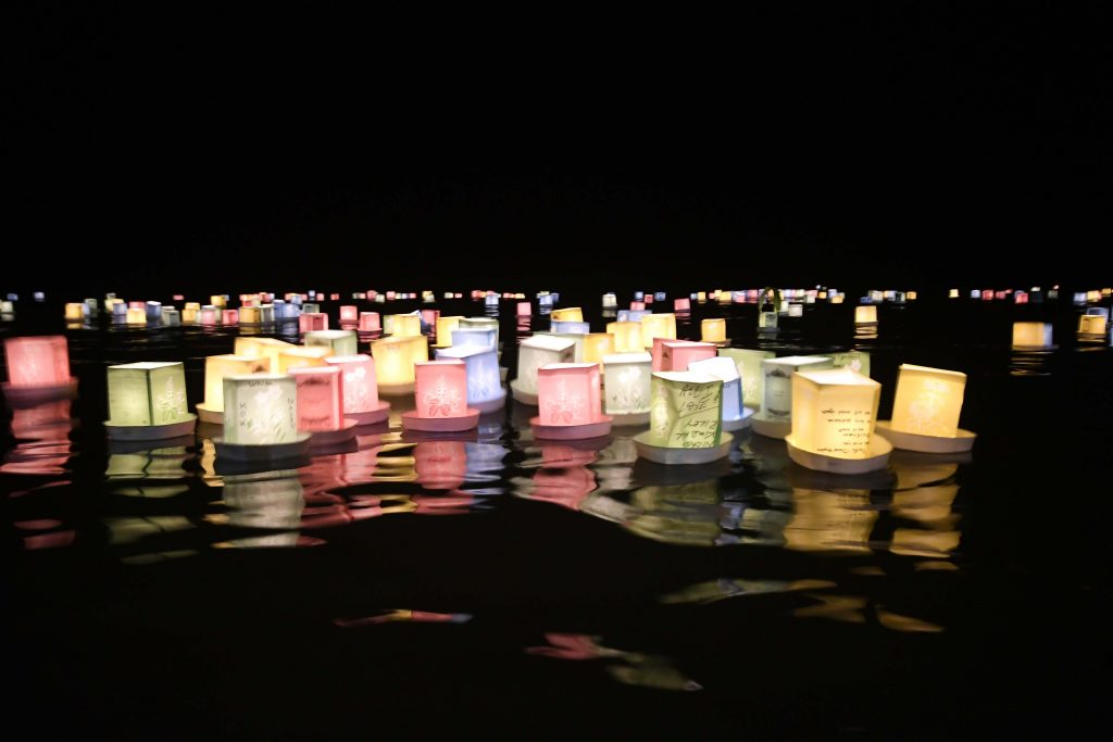 At the end of the night, these lanterns, representing the spirits of departed loved ones, were set afloat in the ocean behind the Haleiwa Jodo Mission to begin their journey back to the spirit world. At next year's obon season, they will return once again to visit and dance with their loved ones.