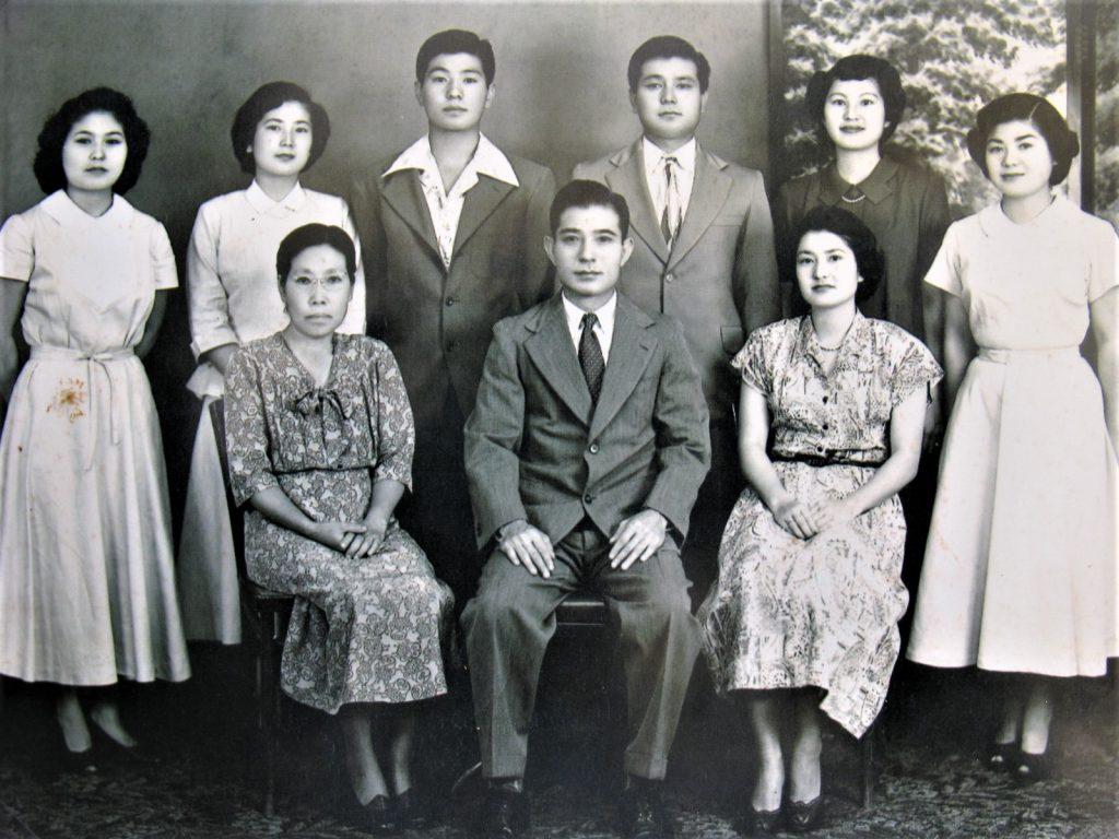 Seated from left: Kamei and Jiro Nakasone and daughter Shizuko Nakasone. Standing from left are their other children: Yoshino, Fumie, Satoru, Seiei, Masae and Sueno Nakasone. Jiro's and Kamei's second son, Junichi, and daughter Yoshino (standing, far left) were taken to Okinawa as children by Jiro's father, Bunchu, and raised by their grandparents. Junichi was killed in the Battle of Okinawa in 1945. (Courtesy: Nakasone family)
