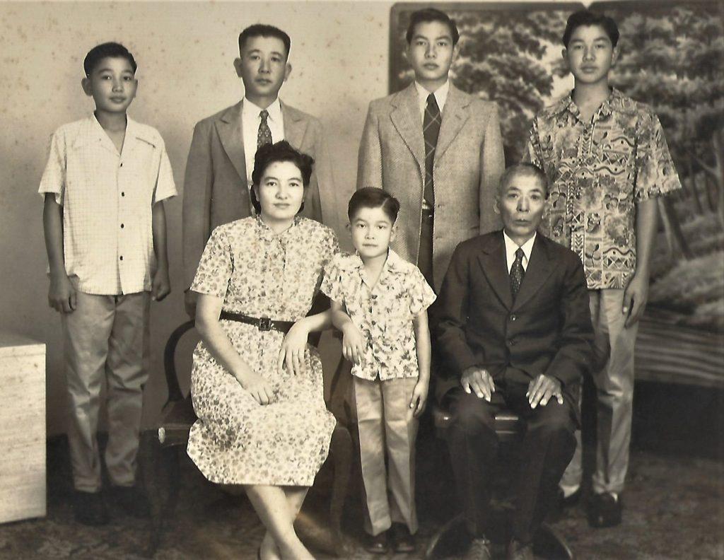 Seated: Tsuruko and Yeison Nakasone with their youngest son Takeshi. Standing from left: son Harry, eldest son Yeiso and his sons, Yeiko and Yeisuke Nakasone. (Courtesy: Nakasone family)