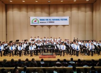 The talented students in the Kaimukï Middle School Symphonic Winds on stage at the Howard L. Schrott Center for the Arts at Butler University with their director Susan Ochi-Onishi (far left). (Photos courtesy Susan Ochi-Onishi)