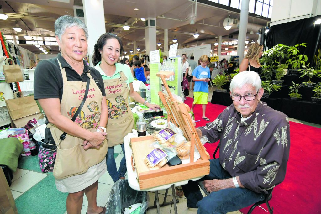 Richard and Avis Mortemore and daughter Marie Inouye flew in from Hilo to show and sell Richard's Hawaiian wildlife paintings, which he markets under the name, Laupahoehoe Graphics. Among their products is a 2020 Hawaiian Wildlife desktop calendar packaged in a CD case. The calendar includes information on native birds and other wildlife found in Hawai'i.