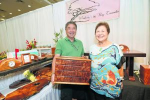Roy Tsumoto and his wife Joan were showing shoppers Roy's selection of handcrafted wood products. According to his website, Tsumoto grew up around woodcrafting because his parents owned Monkeypod Center in Kapälama back in the day. Tsumoto started making jewelry boxes and desk accessories in 1983 while working as a teacher. Now that he is retired, he has more time to devote to his woodworking.