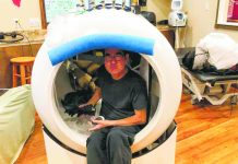 Chef Edwin Goto, hamming it up a bit while receiving a hyperbaric treatment at Healthways in Waimea. (Photo courtesy Goto/Centeio familie
