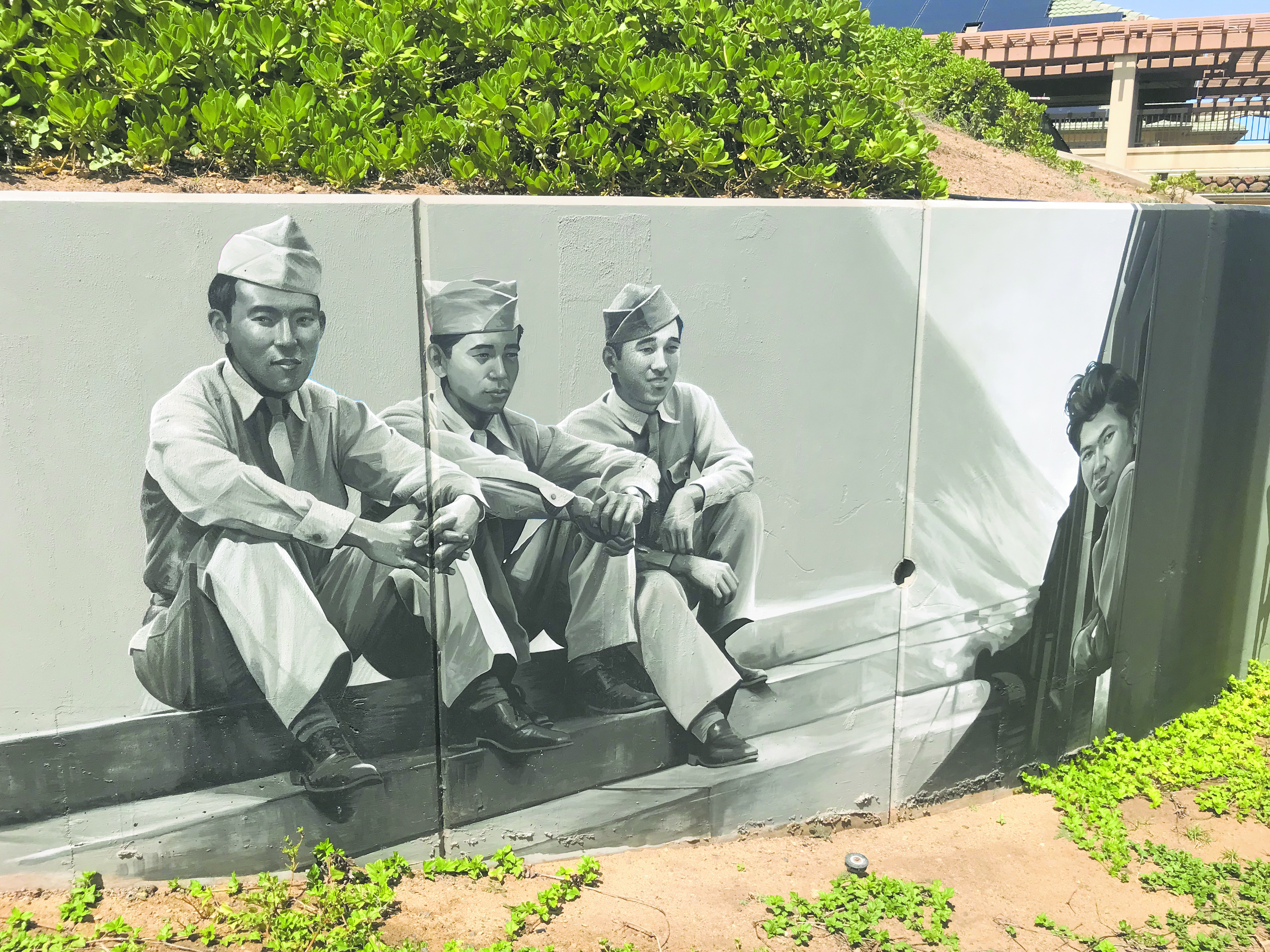 In some sections of the Nisei Veterans Memorial Center mural, the figures of the AJA soldiers stand 6 to 7 feet tall. (Photos by Melissa Tanji)