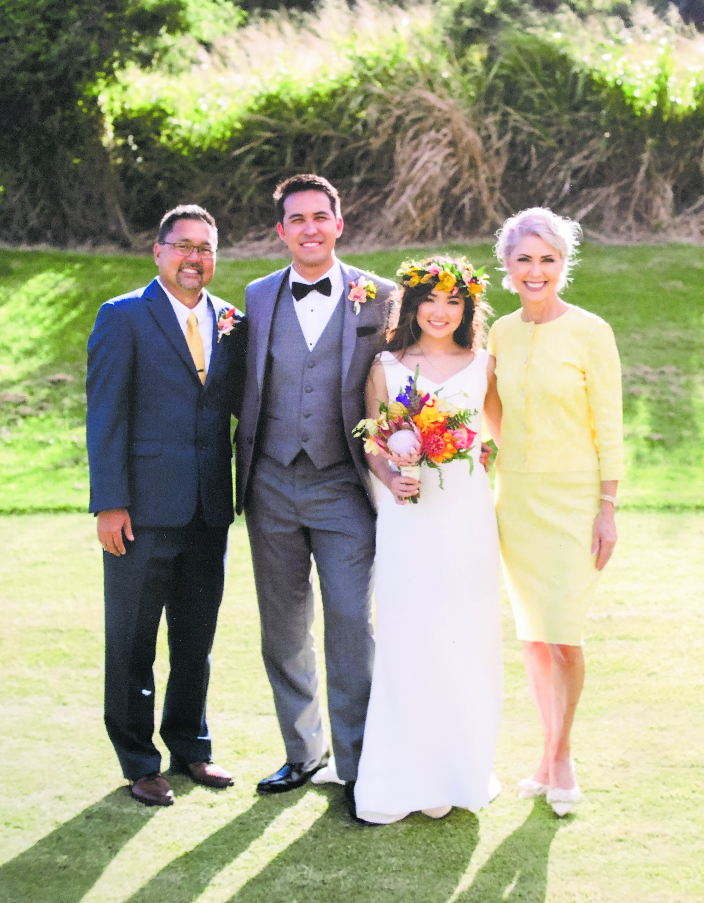 Tom (far left) and Rae (far right) Seki, with their daughter, Tia who married Luke Gage this past May. Tia was the Maui Sons and Daughters of Nisei Veterans Chrysanthemum Queen in 2012.