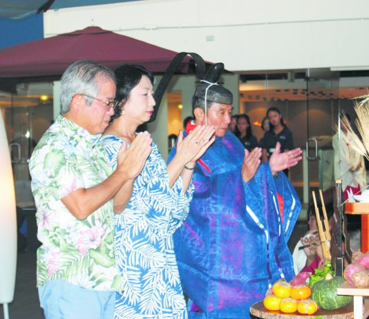 Consul General of Japan, Koichi Ito, and his wife, Misako Ito, give thanks and receive blessings as they pray at the altar with Rev. Akihiro Okada of the Daijingu Temple of Hawaii.