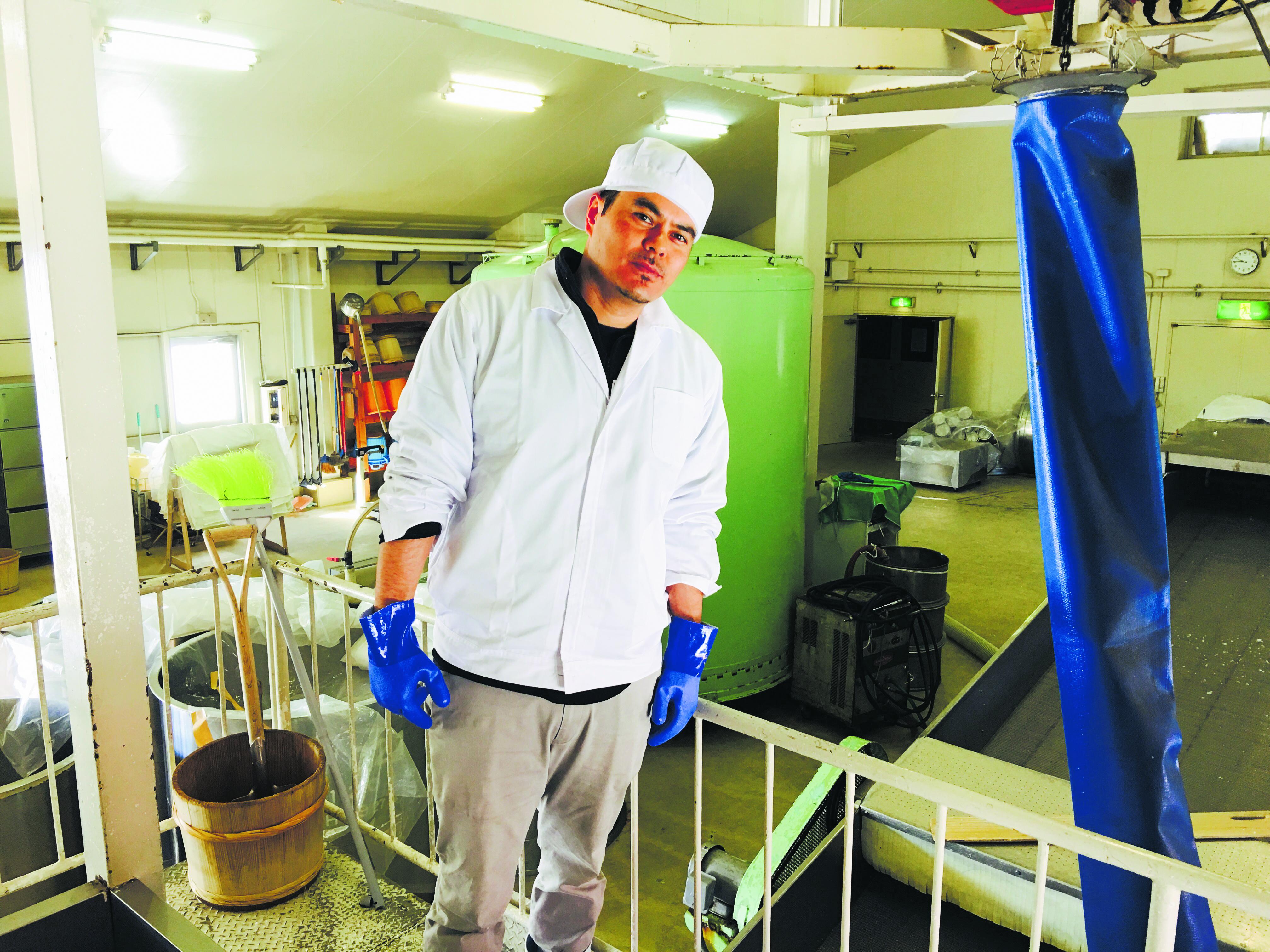 Pearce working at Dewazakura Sake Brewery.