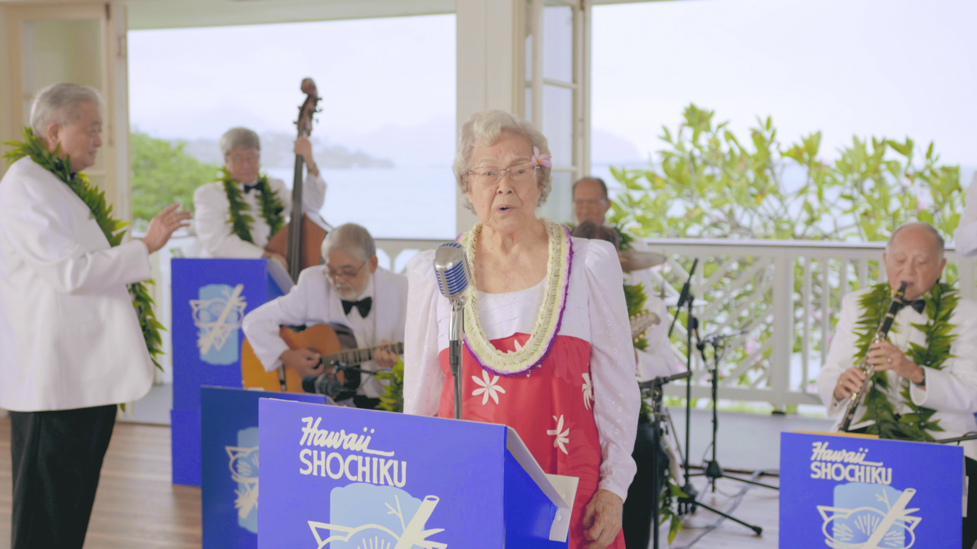 """Grace Amemiya was an original member of Hawaii Shochiku Orchestra, which was a popular Nisei orchestra post-World War II. In the film, she sang """"Wakare no Iso Chidori,"""" as a representation of the Nisei generation in Hawai'i."""