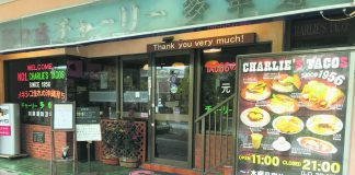 The storefront of Charlie's Tacos in Okinawa City.