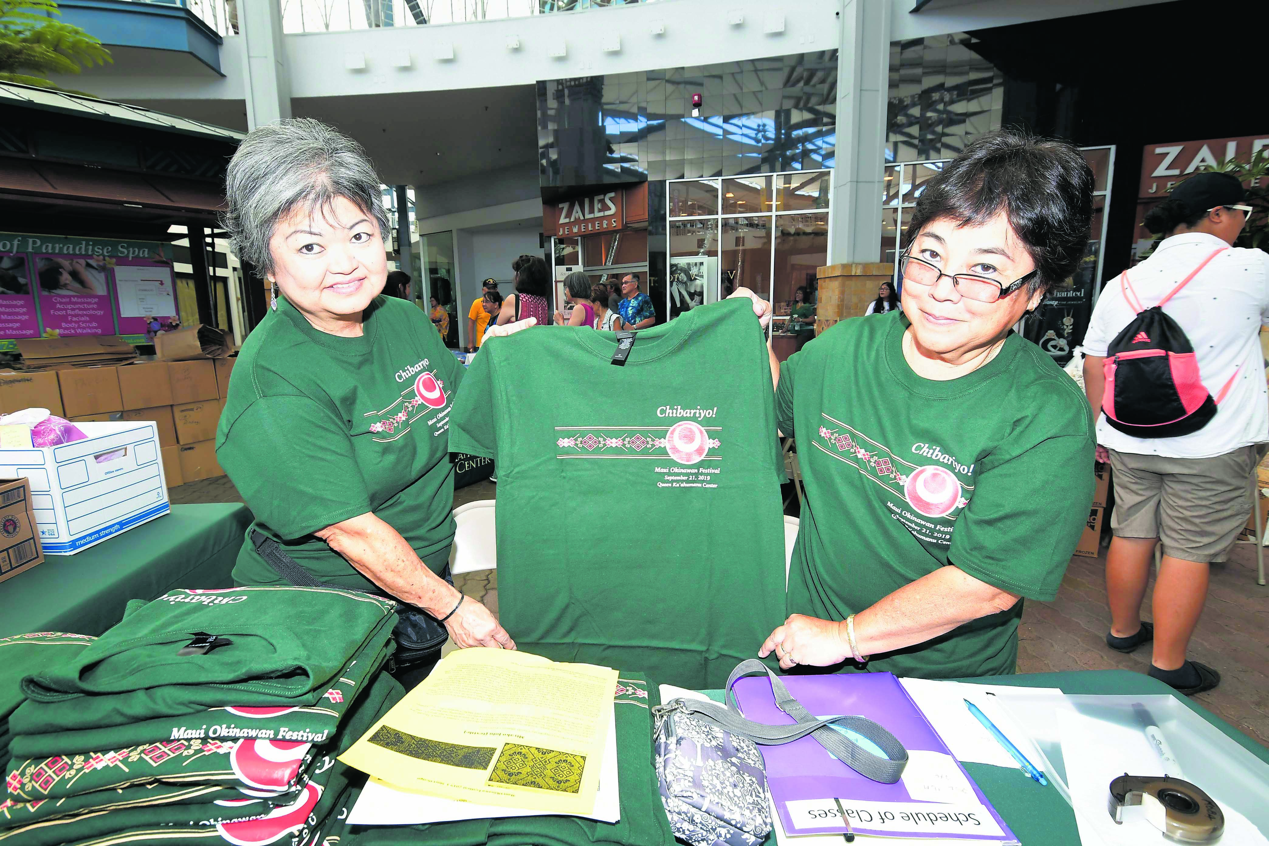 Maui Okinawa Kenjin Kai members Amy Yamada (left) and Eileen Kobayashi were busy selling Festival T-shirts.