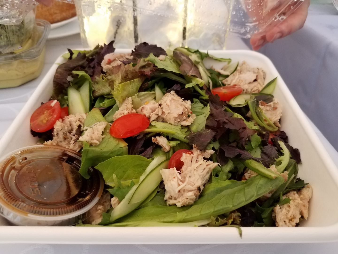 """The Ahi Conserva with Arcadian mixed greens, local tomato, and shaved cucumbers — one of the dishes included in La Tour Bakehouse's """"picnic baskets."""""""