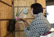 Omotesenke Domonkai Hawaii member Reiko Lewis carefully waters her floral arrangement during the hanayose (flower offering) — one of the Seven Exercises, or Shichiji-shiki, established by Sösa Sen VII (1705-1751).