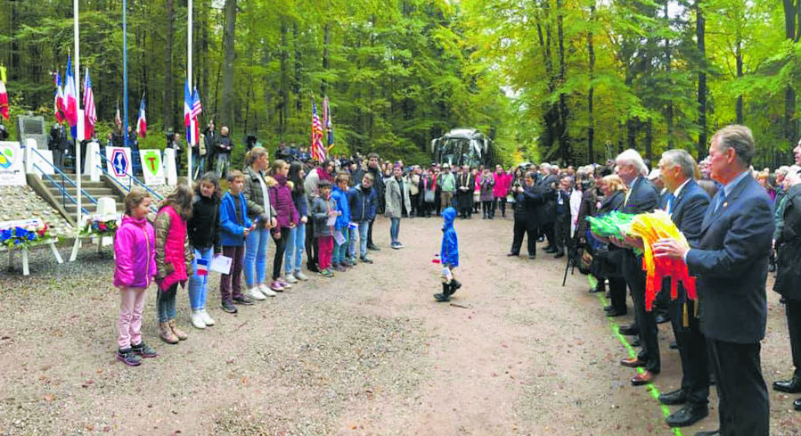French children, many of them descendants of the people who were liberated by the AJA soldiers in 1944, line up in the Helledraye Forest. From a very young age, the children of Bruyères are taught about the AJA soldiers who gave their families back their freedom.
