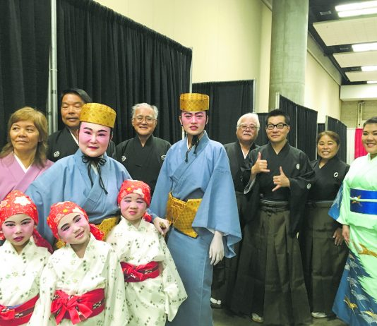 Azama Honryu Traditional Okinawan Dance School and Nomura Ryu Dento Ongaku Kyokai (Denon) at this year's Hawaii United Okinawa Association Okinawan Festival at the Hawaii Convention Center. (Front row: Hayli, Adele and Kelsi; Middle row: Allison Yanagi and Aren Pai; Back row: Kathy Oshiro, Dennis Nishiguchi, Terry Higa of Hawaii Taiko Kai, Richie Yamashiroya, Lynn Miyashiro Masuda of Afuso Ryu Gensei Kai Hawaii and Sara Nakatsu of Ryukyu Sokyoku Koyo Kai.