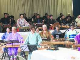 The koto players performing in the Goudou Ensou Kai (from left): Courtney Takara, Kathy Shigemura, Kazuko Ito-Sensei, Grace Carmichael, Robbie Umeno, Kinuko Tamashiro and Diane Kawamoto. They were joined by other koto and sanshin players in the front row on the stage (from left): Zachary Oyafuso, Sarah Nakatsu (koto), Brandon Ing, Derek Fujio (koto), Seichi Yagi-Sensei and Lisa Sadaoka (koto).