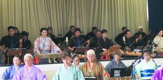 The koto players performing in the Goudou Ensou Kai (from left): Courtney Takara, Kathy Shigemura, Kazuko Ito-Sensei, Grace Carmichael, Robbie Umeno, Kinuko Tamashiro and Diane Kawamoto. They were joined by other koto and sanshin players in the front row on the stage (from left): Zachary Oyafuso, Sarah Nakatsu (koto), Brandon Ing, Derek Fujio (koto), Seichi Yagi-Sensei and Lisa Sadaoka (koto).