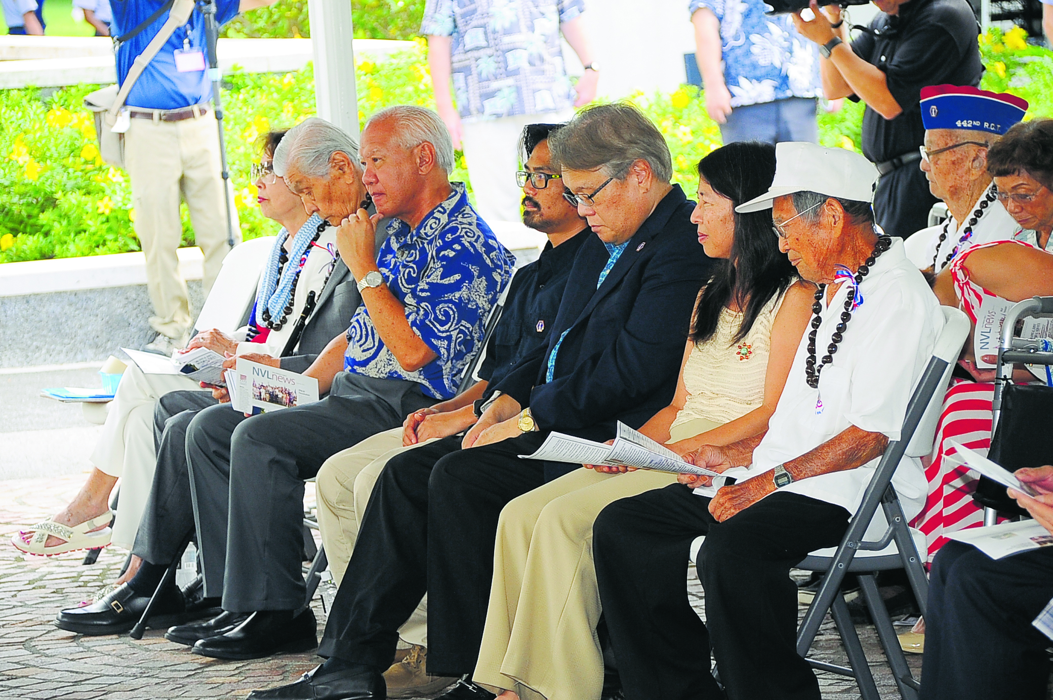 Representing the four World War II AJA veterans groups at the Joint Memorial Service were, from left: former first lady Jean Ariyoshi and former Gov. George Ariyoshi, a Military Intelligence Service veteran; state Rep. Gregg Takayama, son of a 1399th Engineer Construction Battalion veteran; James and Karl Okemura, grandson and son, respectively, of a 442nd Regimental Combat Team veteran; Tsurumi Hamasu, daughter of 100th Infantry Battalion veteran Mitsuo Hamasu; and 100th Infantry Battalion veteran Masaharu Saito.