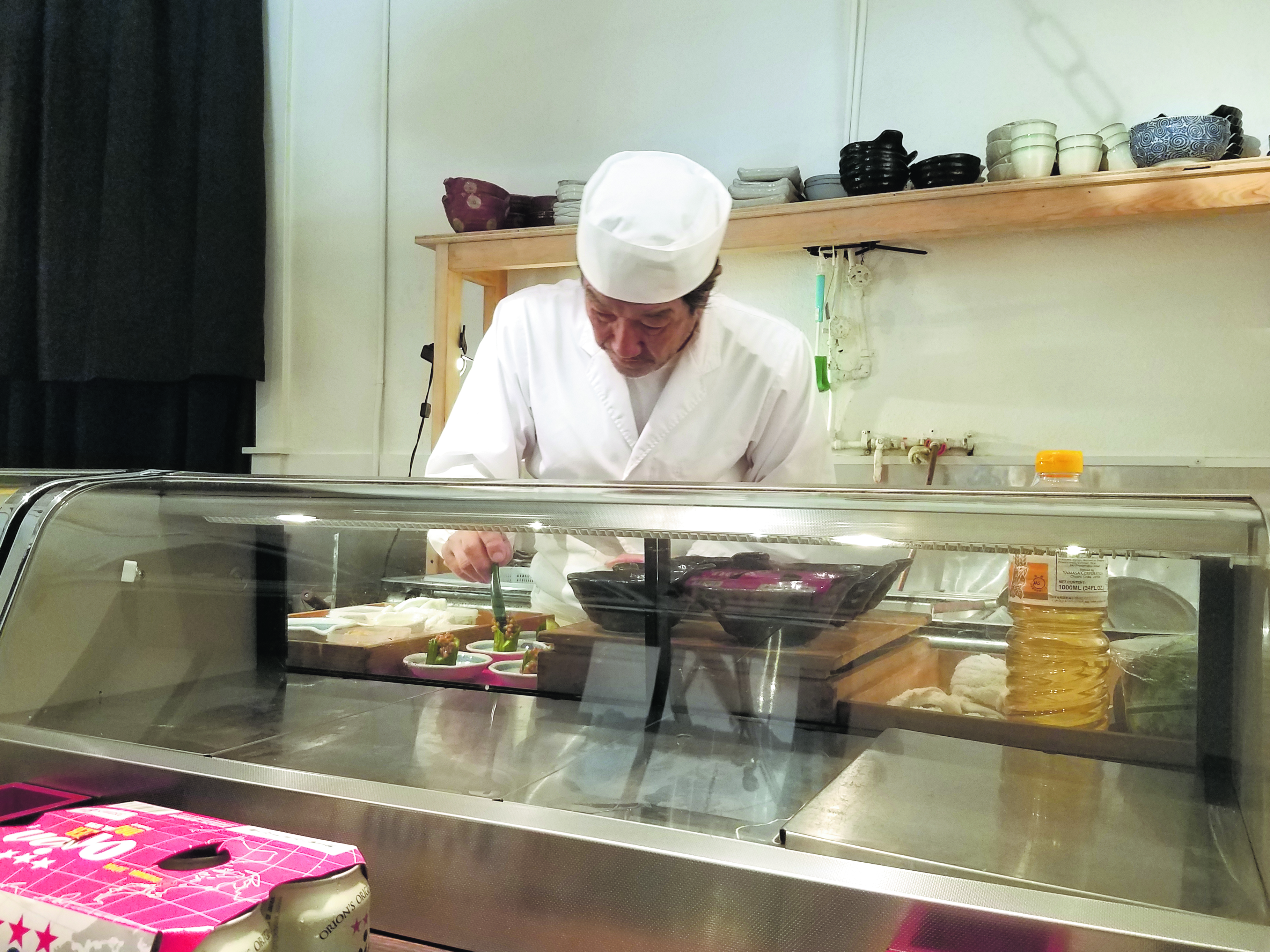 Chef Taka Kijima mindfully preparing dishes for his omakase dinner guests.