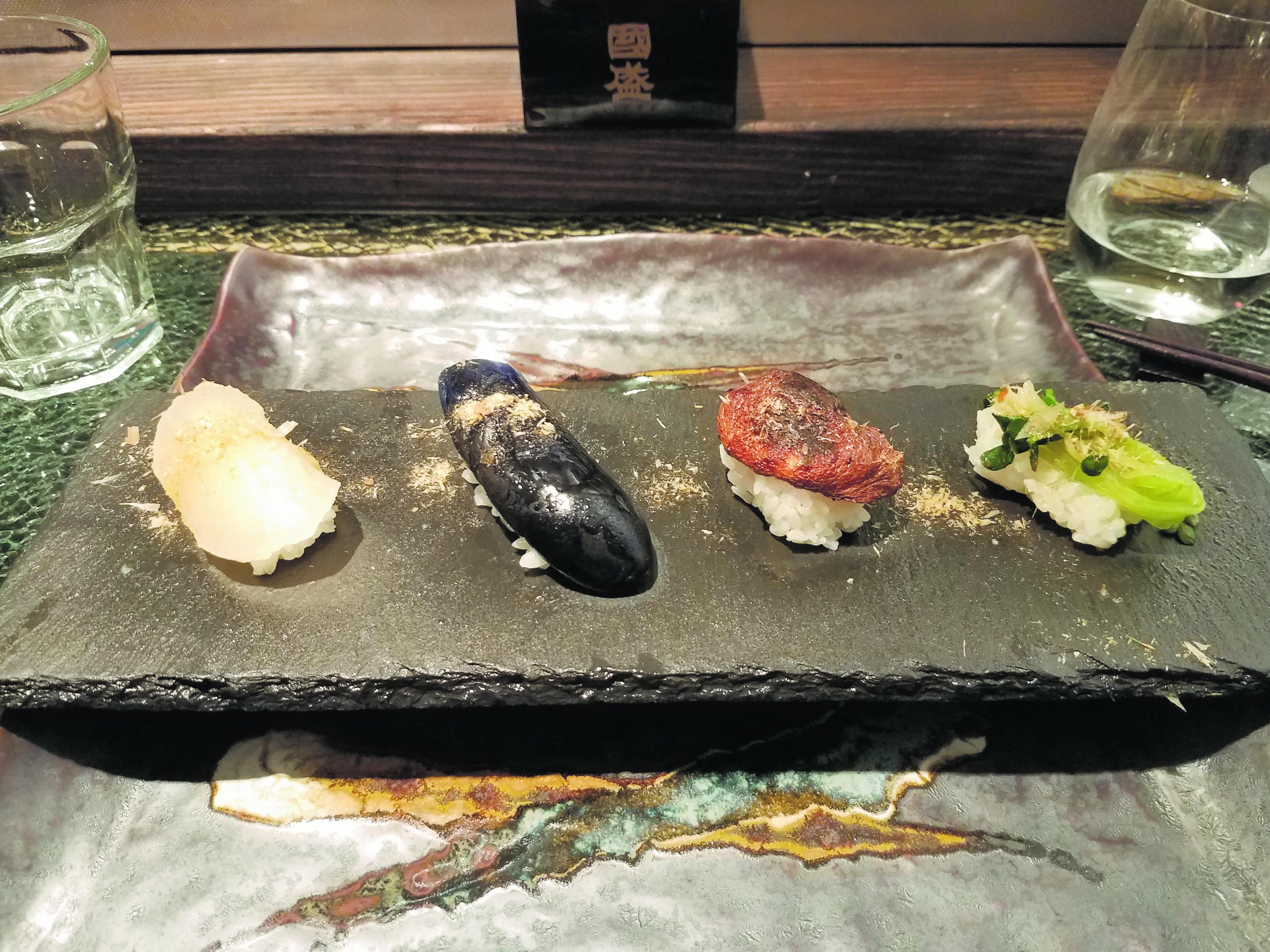 Veggie nigiri: quartet of takuan, nasubi, shiitake and peas shoot nigiri.