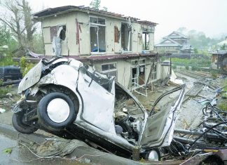 This house and car were damaged by gusty winds in Ichihara, near Tökyö, on Oct. 12, just before Typhoon Hagibis made landfall. (Kyodo News Photo)