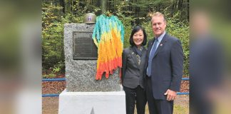 Congressman Ed Case and his wife Audrey at the monument dedicated to the 100th/442nd soldiers in the Helledraye forest above Bruyères. Mayor Kirk Caldwell brought the folded paper cranes to Bruyères at the request of Hiroshima City Mayor Kazumi Matsui. (Photos courtesy Congressman Ed Case)