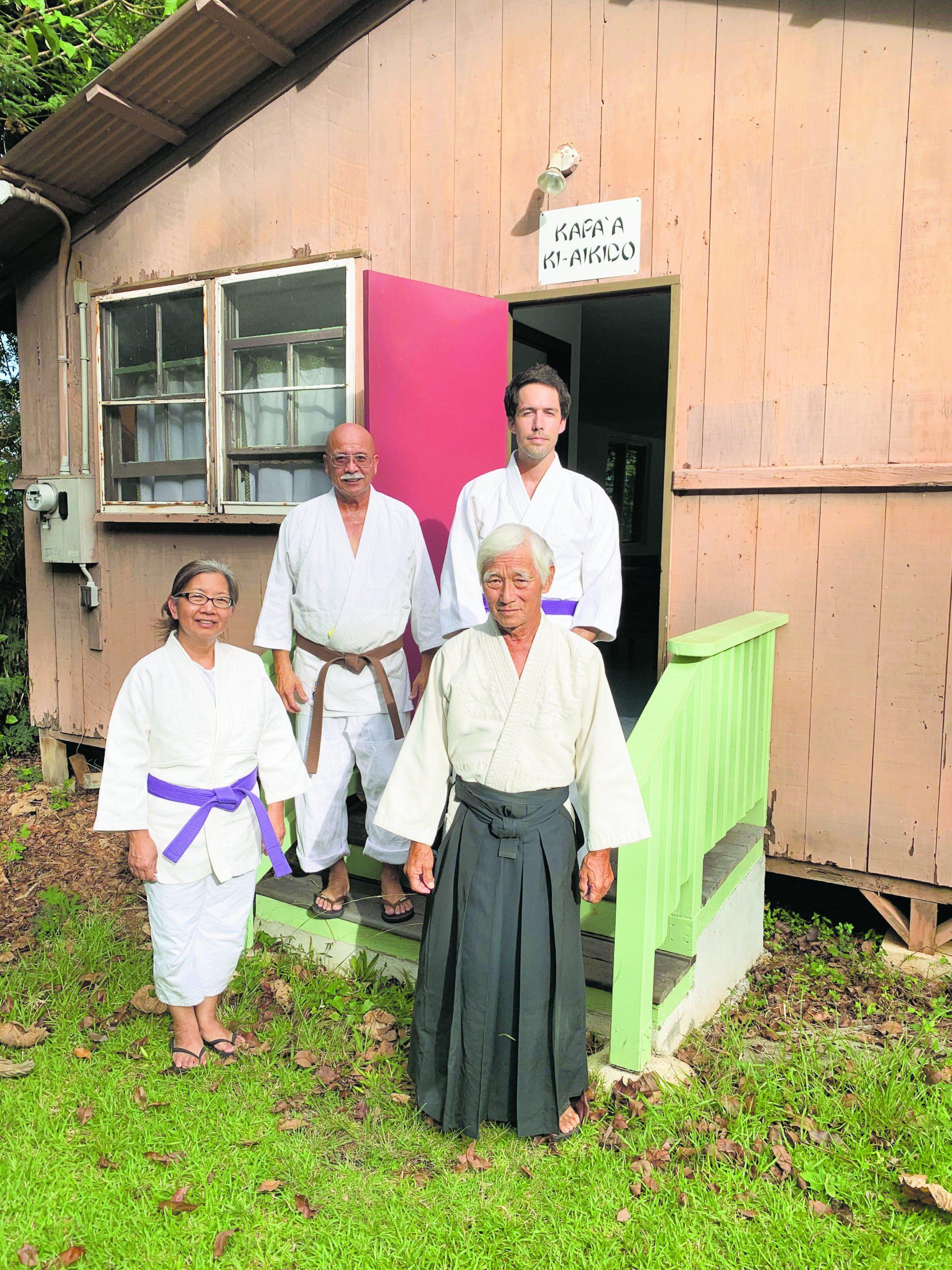 Lloyd Miyashiro-Sensei (wearing black hakama) with his Kapa'a Ki-Aikido students. Standing with him on the ground is Jan Hashizume. Behind them are Gene Hashimura and Brian Gerald.