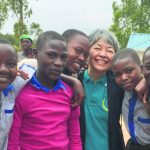 Sakai with several Rwandan orphans who she helped overcome trauma. Many of them saw their parents die in the genocide and used TFT to help stop nightmares and overcome post-traumatic stress disorder. (Photo courtesy Caroline Sakai)