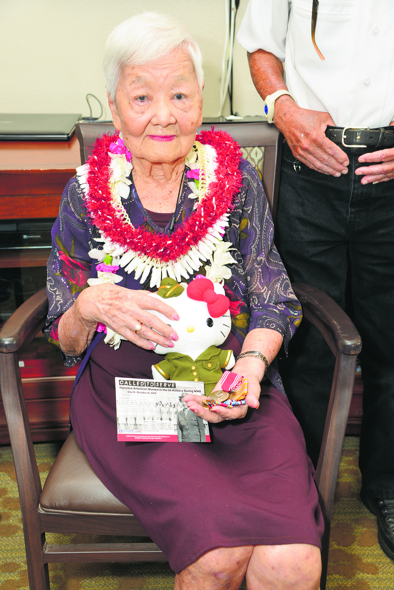 """Chito Isonaga holds her medals and a Hello Kitty WAC doll that was specially commissioned by the Go For Broke National Education Center for its """"Called to Serve"""" exhibit on the Women's Army Corps. It was presented to her by 100th Infantry Battalion Veterans president Ann Kabasawa. (Photo by Clyde Sugimoto)"""