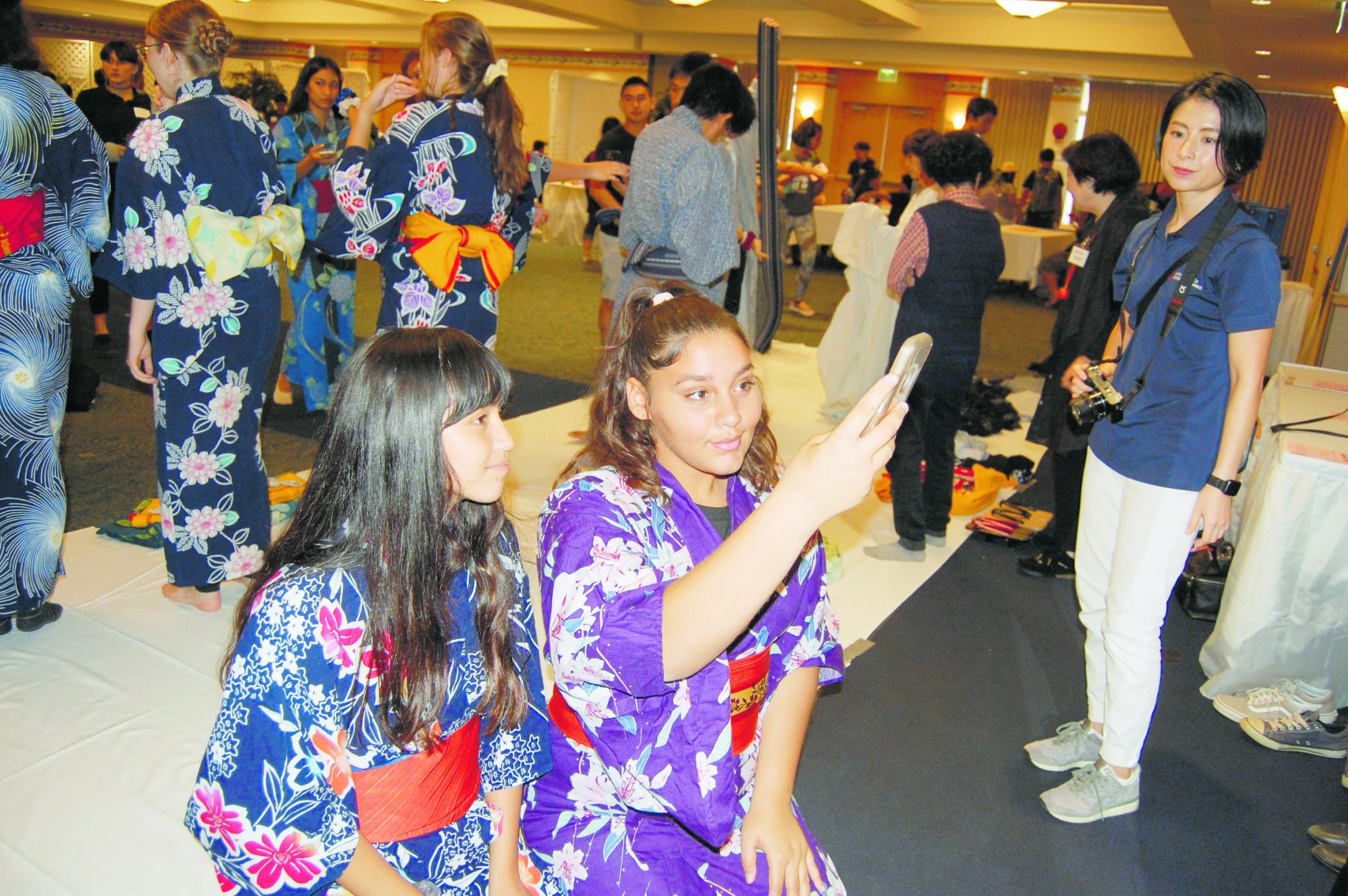 Kaililauokekoa Asuncion (left) and Ashawnaleigh Davis from Moloka'i High School take a selfie after getting dressed in kimono. Since 1993, over 6,700 students from 65 different schools have participated in JASH's Japan Day.