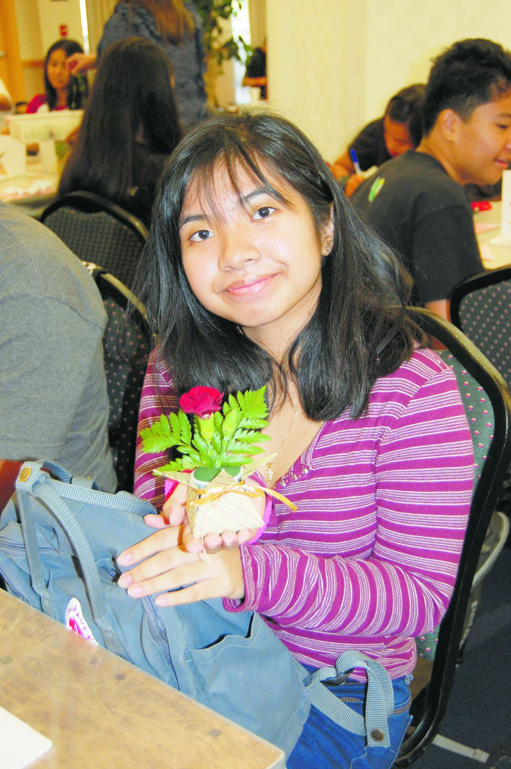 Meagan Reese of Kailua High School shows off her flower arrangement. Dawn Kanno from MOA Hawaii taught the ikebana workshop.