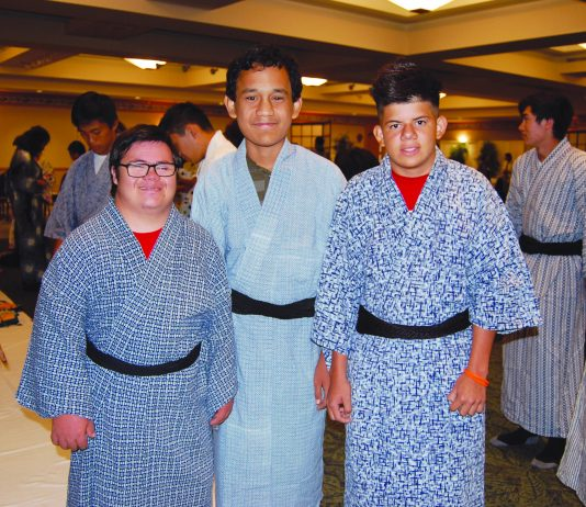 Kailua High School students (from left) Luke Tobias, Skye Simbahon and David Valaderes wearing yukata kimono for the first time. (Photos by Jodie Ching)